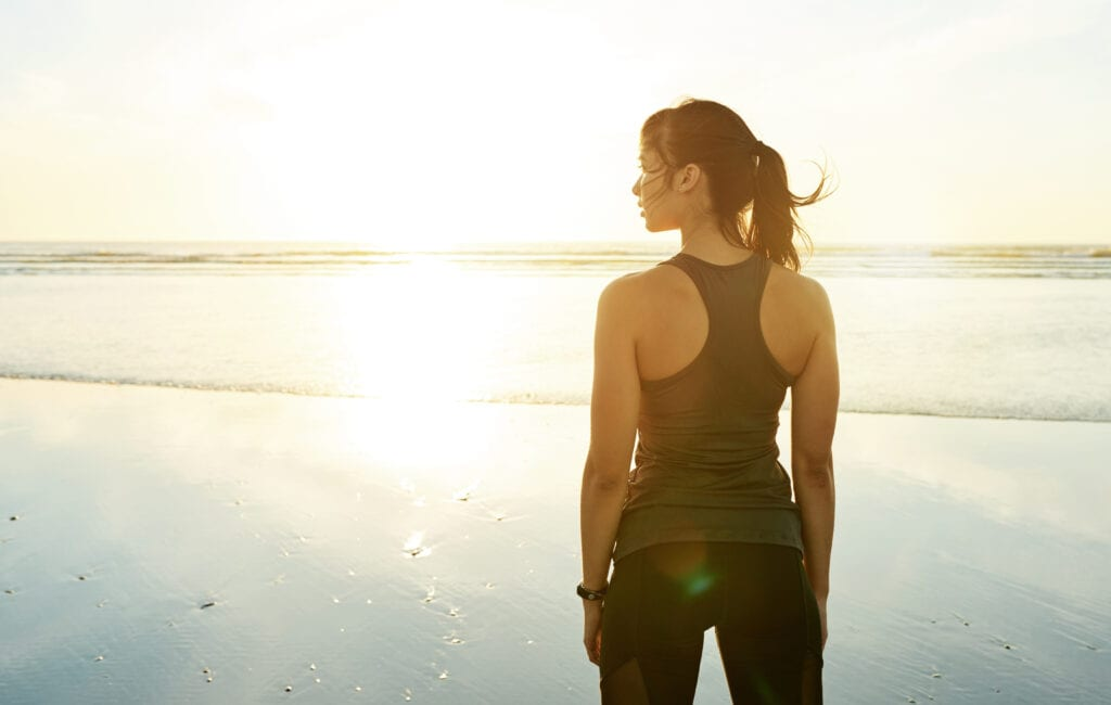 Fit woman thinking