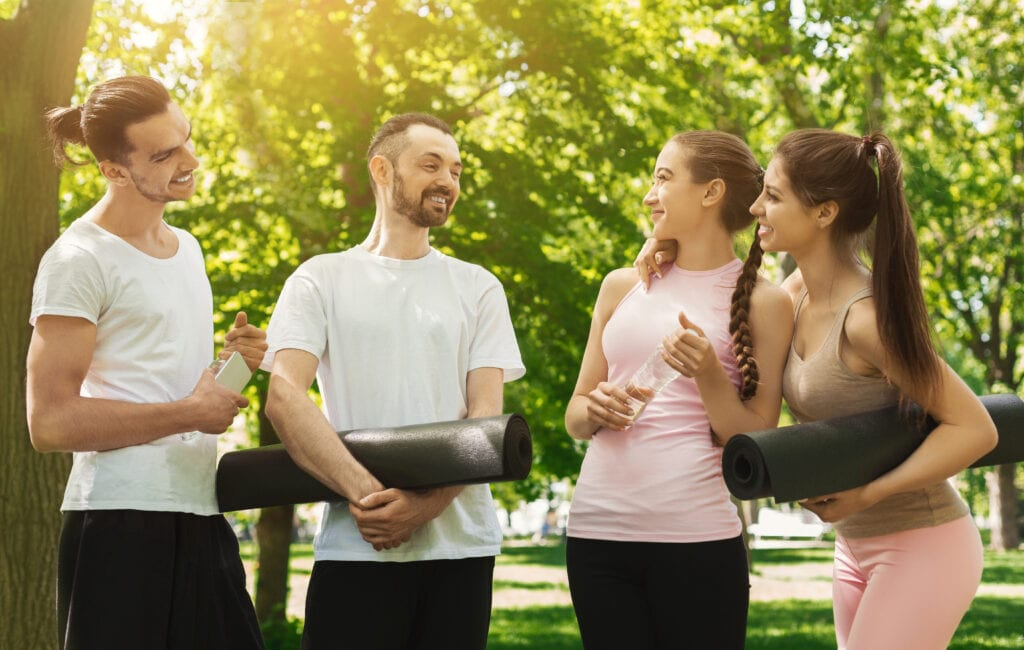 Pilates students talking after workout outside the studio