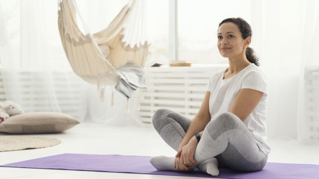 Fitness woman visualizing while on the mat