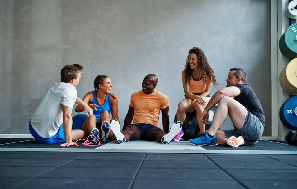 Pilates students talking after workout
