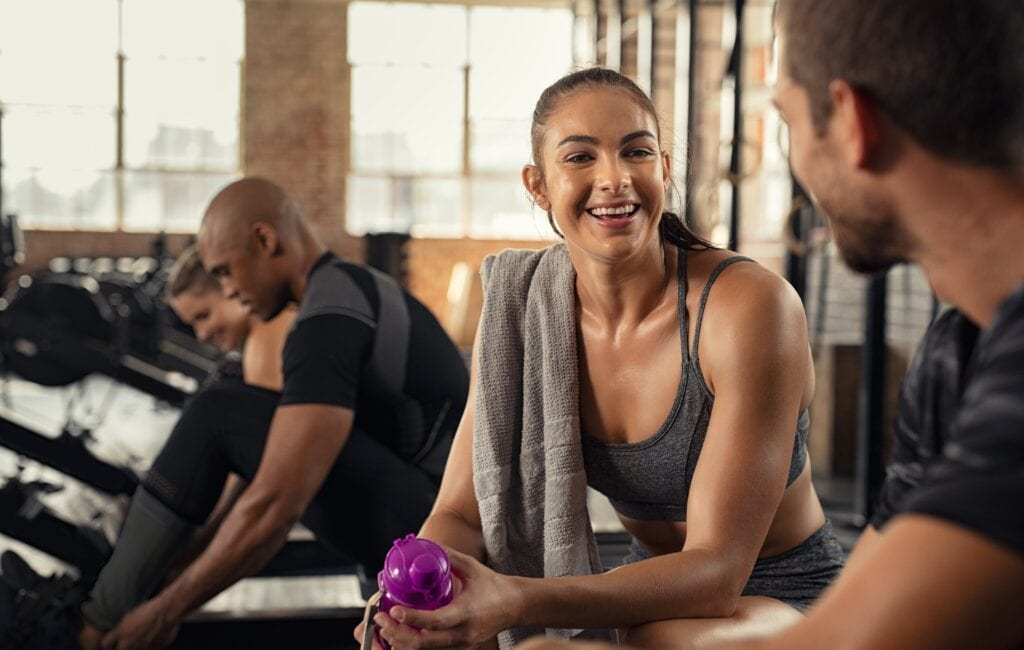 Pilates intsructor happy chatting with her client after workouts