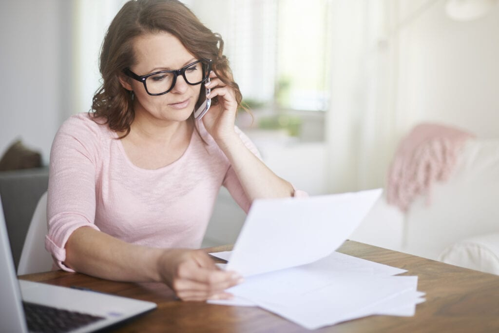 Woman busy working at home