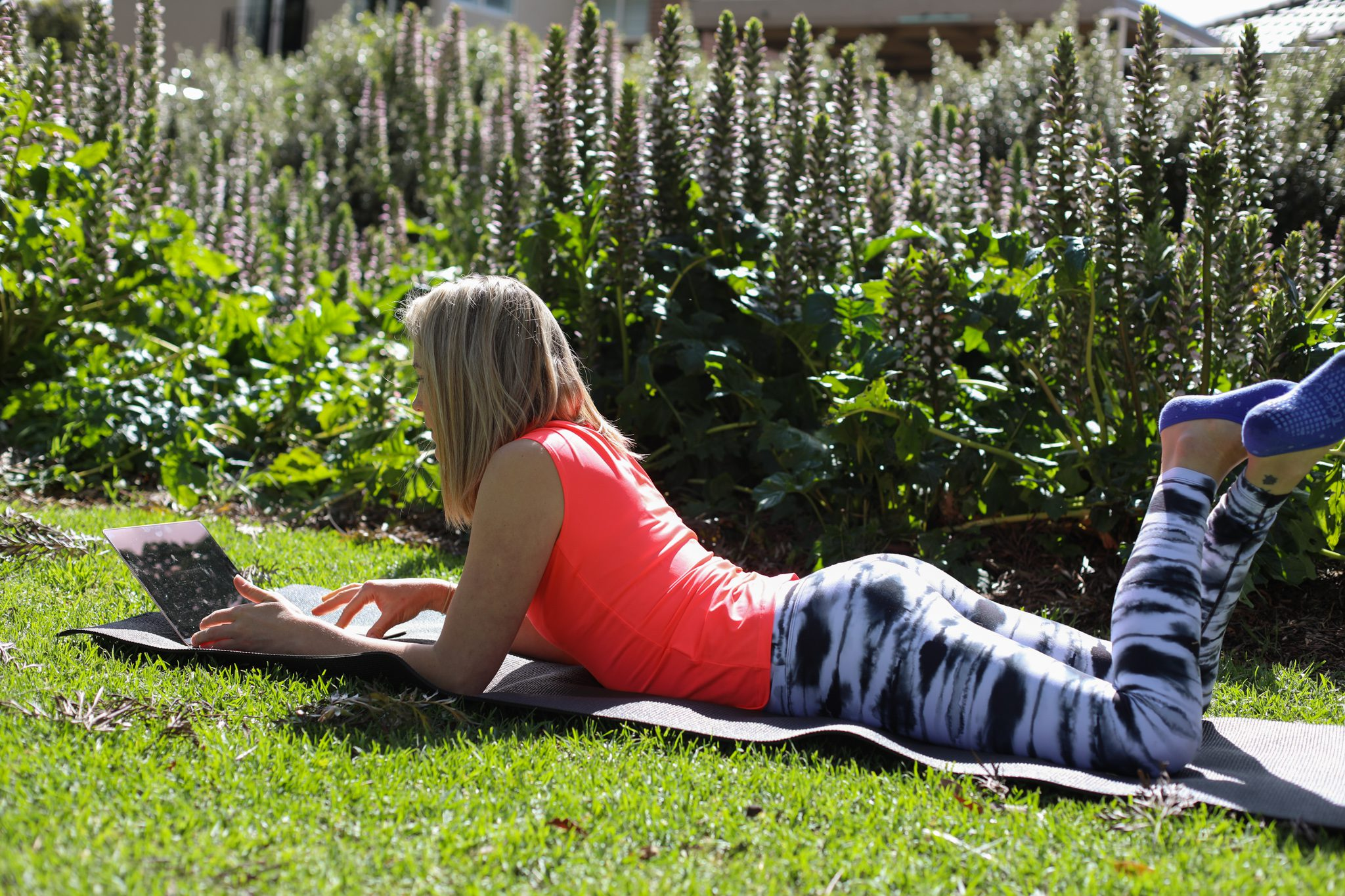 Female watching Pilates exercise in the garden