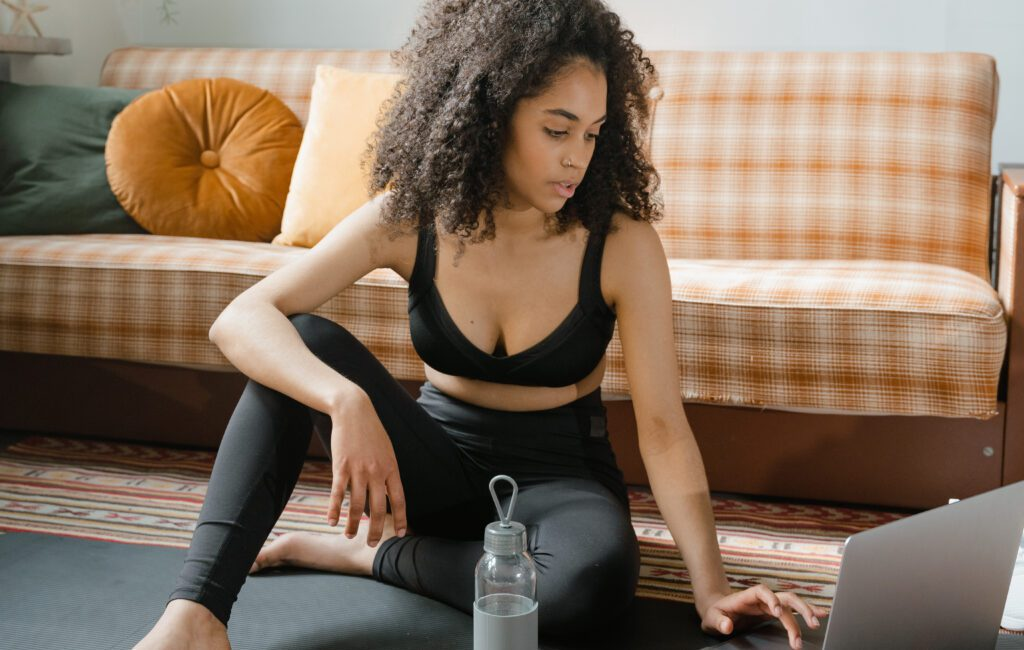Fitness woman checking her laptop after workout