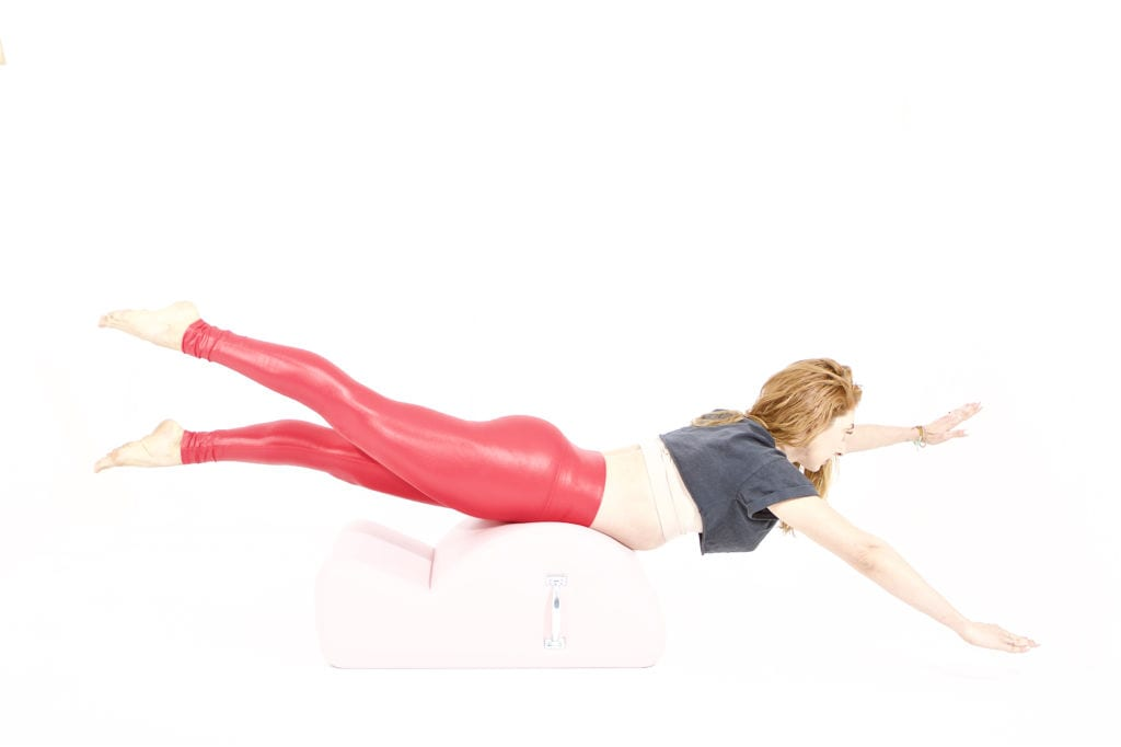 Swimming on the Spine Corrector   Online Pilates Classes