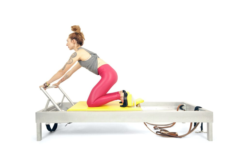 Knee Stretches Flat Back on the Reformer | Online Pilates Classes