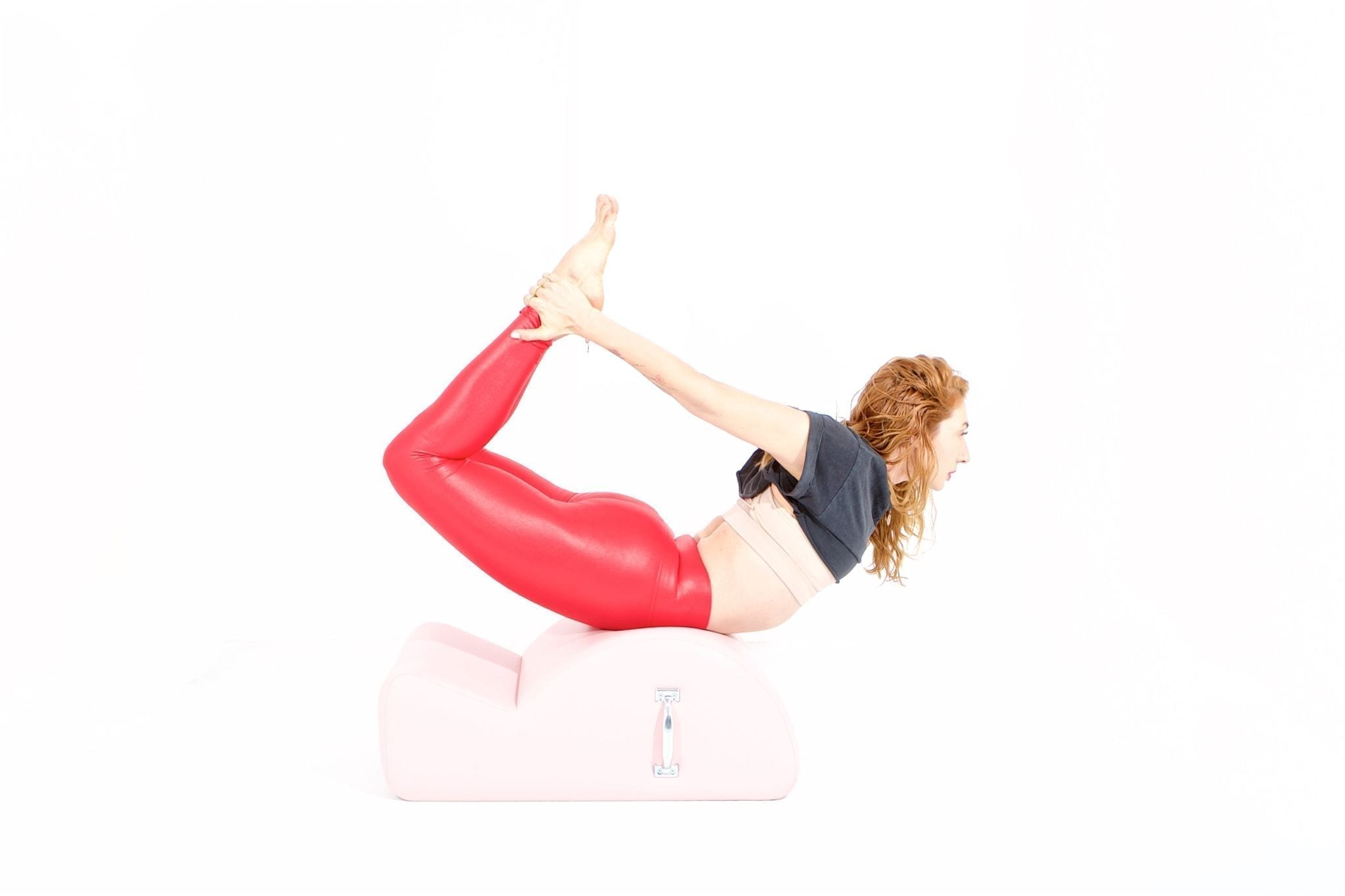rocking on the spine corrector   online pilates classes