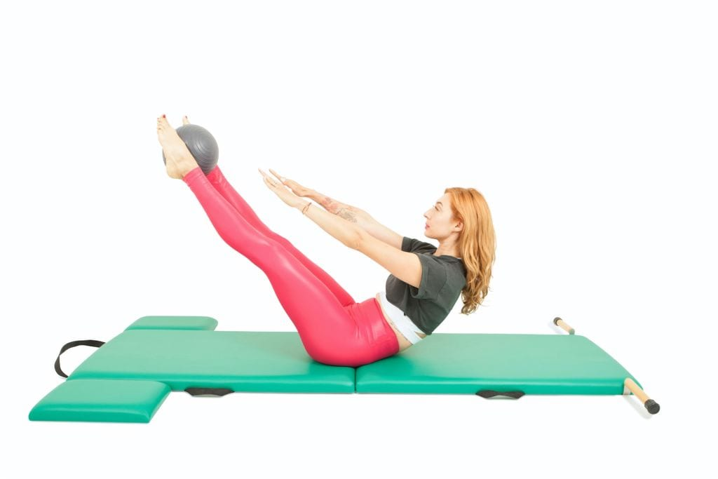 Teaser with a Ball on the Mat | Online Pilates Classes
