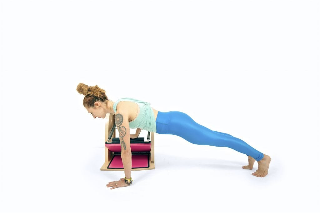 One Arm Push Ups From the Floor on the Wunda Chair | Online Pilates Classes