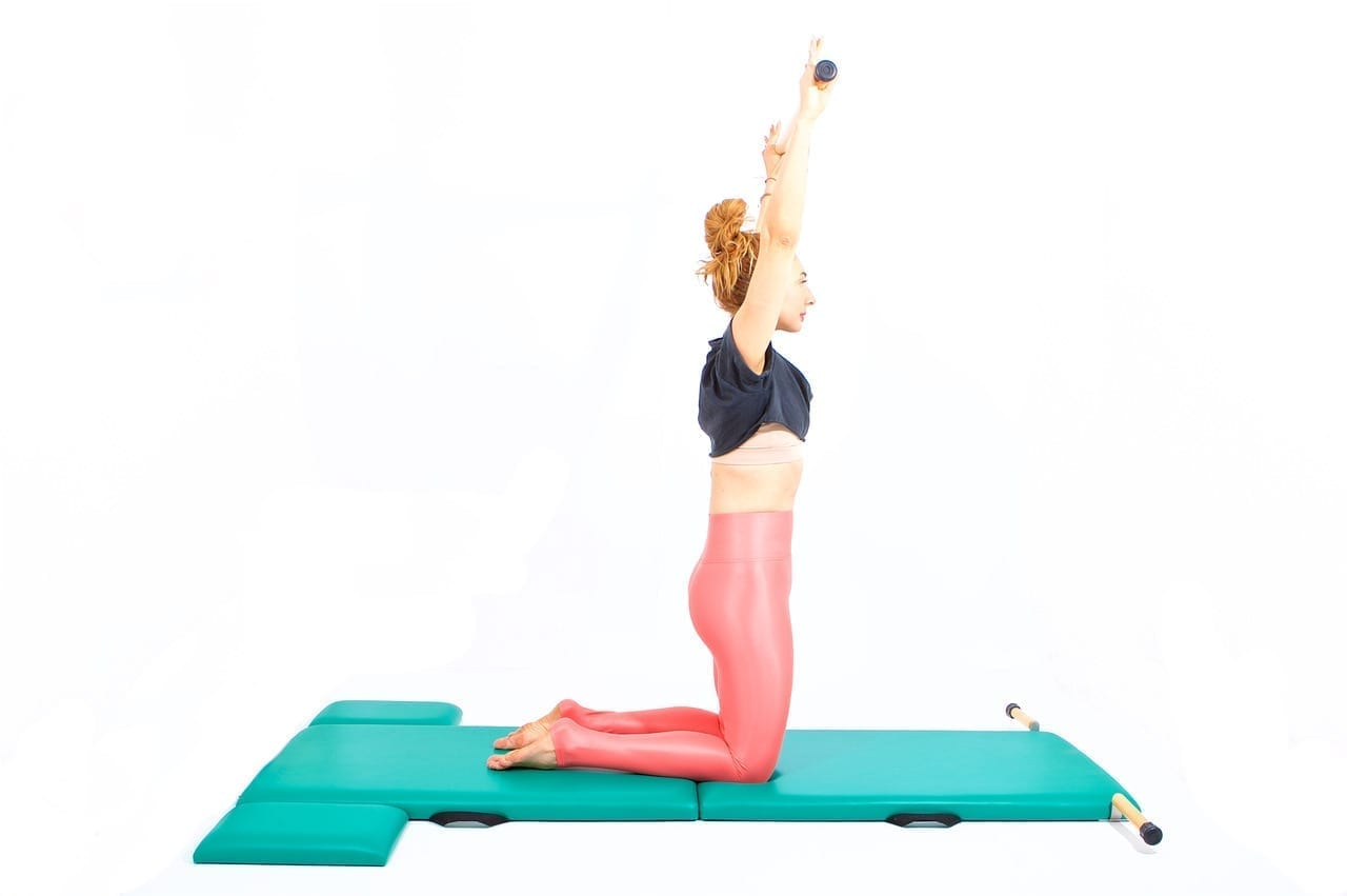 Transitions between Exercises Spine Stretch Forward to Thigh Stretch on the Mat | Online Pilates Classes