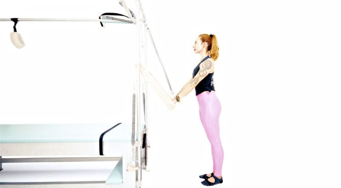 Standing Push Through on the Cadillac | Online Pilates Classes