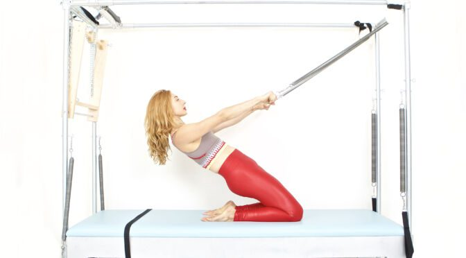 thigh stretch on the cadillac | Online Pilates Classes