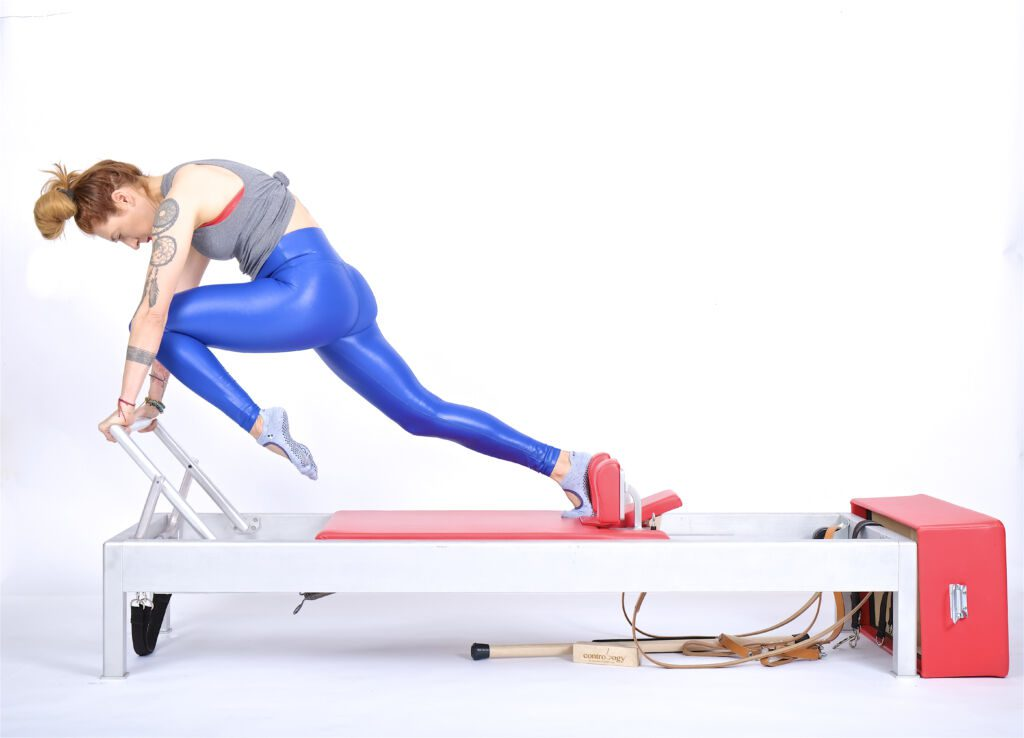 knee stretches single leg knees off on the reformer | Online Pilates Classes