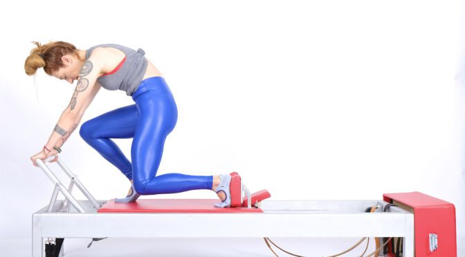knee stretches single leg knees off prep on the reformer | Online Pilates Classes