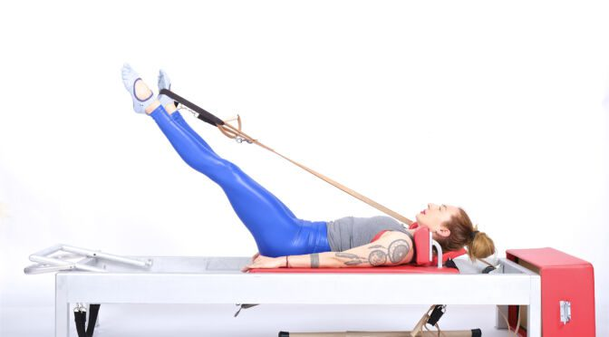 leg circles single foot in strap on the reformer | Online Pilates Classes