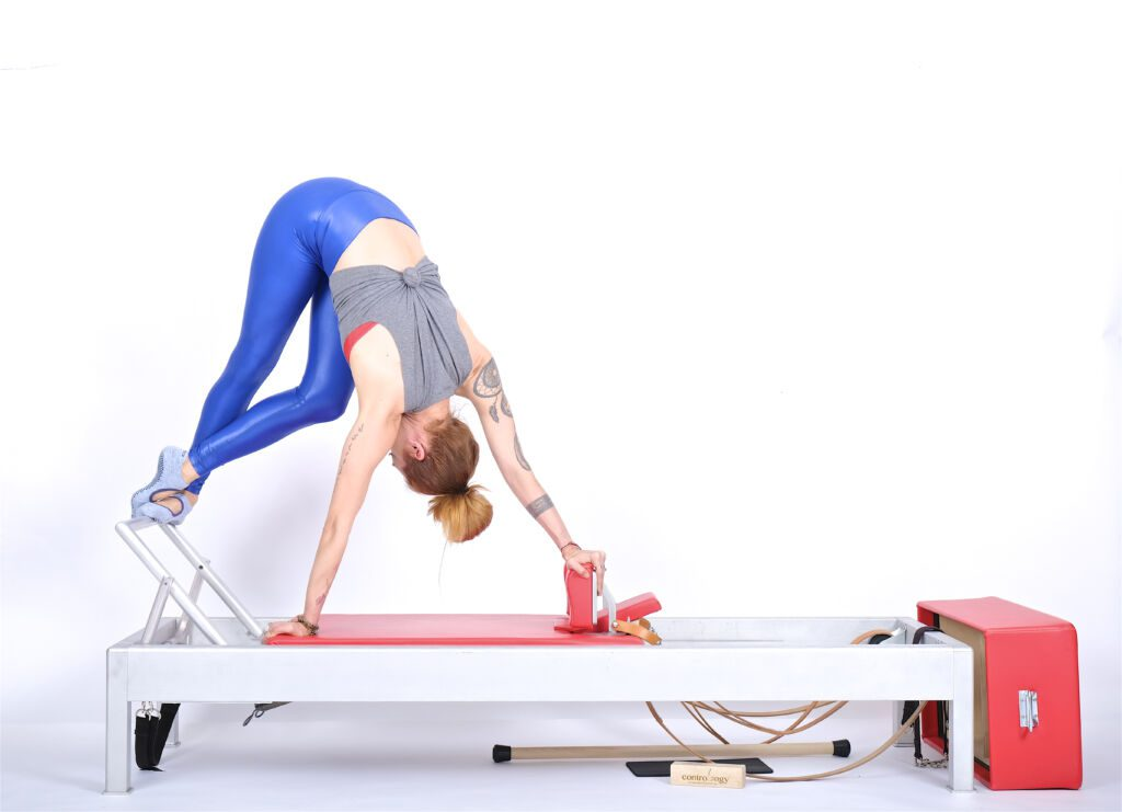 snake and twist bar up on the reformer | Online Pilates Classes